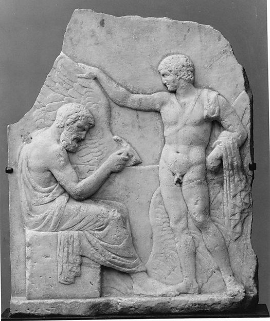Relief of the craftsman Daedalus, seated, perfecting the famous wings he will use to fly to freedom. His son, Icarus, stands at his side. Metropolitan Museum of Art.